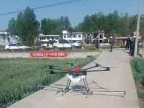 西峡:麦田无人机农药喷洒